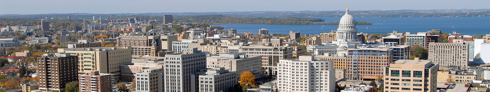 Aerial view of Madison city skyline. UW Madison campus in the background.